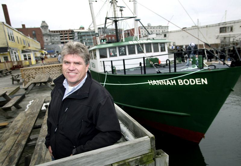 Jon Williams, a fisherman from Westport who has built a business around deep-sea red crab fishing, stands near his boat, the Hannah Boden, along the Portland waterfront.