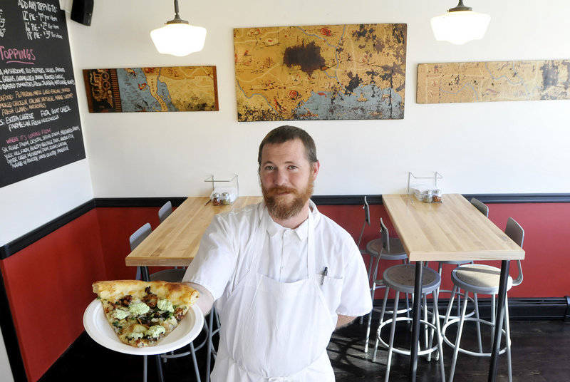 Bob Haggerty, manager of Flipside, with a roasted potatoes, scallions, bacon and basil ricotta slice.