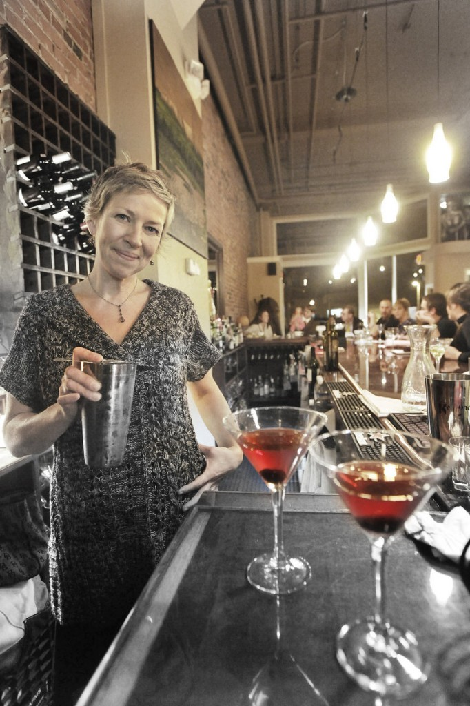 Co-owner and bartender Winnie Moody mixes martinis.