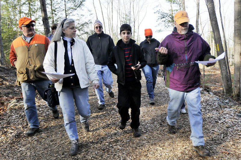 Paul Gadbois, right, an advisory board member with Blandings Park Wildlife Sanctuary in Biddeford, leads a hike in the preserve on Sunday. With him, from left, are Paul Brady, Michelle Larkin, Mark Larkin, Steven Larkin and Amanda Noble.