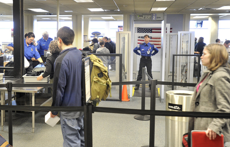 Travelers await screening by Transportation Security Administration employees Tuesday in Portland. The TSA plans to expand the use of X-ray body scanners at airports next year, but a spokeswoman said she couldn't say whether Portland will get one.