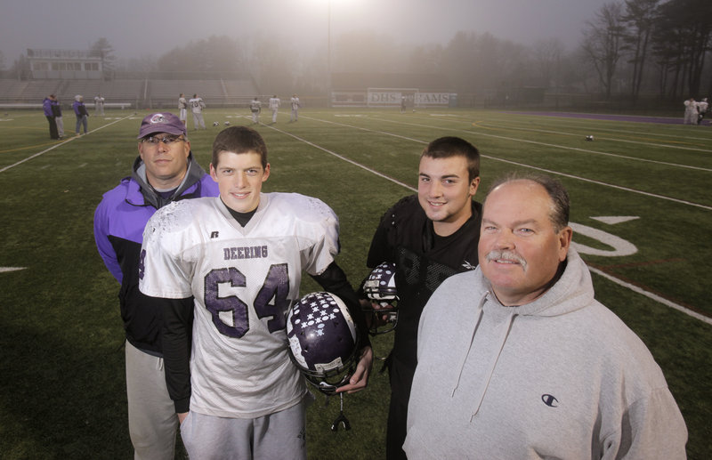 They've lived through the season together as father and son, and coach and player. Today they will be on the sidelines together again. Representing Deering are, left, head coach Greg Stilphen and his son, Alex; and assistant coach Ted Ross and his son, Jamie.