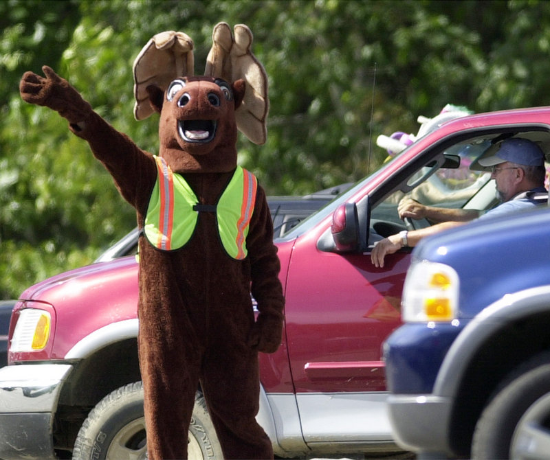 Each Labor Day, Dan Paradee, the Maine Turnpike Authority's first public relations manager, became Miles the Turnpike Moose at the York toll plaza, handing out token gifts to tourists and thanking them for visiting Maine.