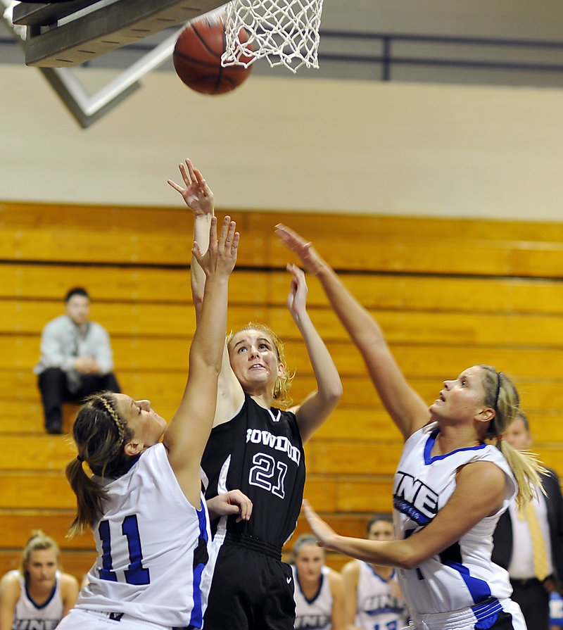 Ellery Gould of Bowdoin finds space to shoot between Liz LeBlanc, left, and Kelley Paradis of UNE. To go with a strong defense, the Polar Bears shot 50 percent, and were 10 of 18 on 3-pointers.