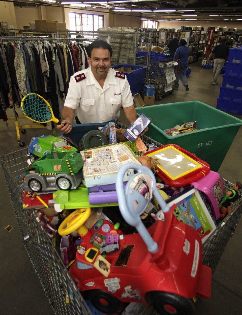 Salvation Army Maj. Henry Graciani shows toys that the San Diego, Calif., office hopes holiday shoppers might like.