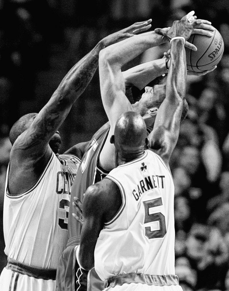 Shaquille O'Neal, left, and Kevin Garnett of the Boston Celtics sandwich Brook Lopez of the New Jersey Nets during Boston's 89-83 victory at home Wednesday night.