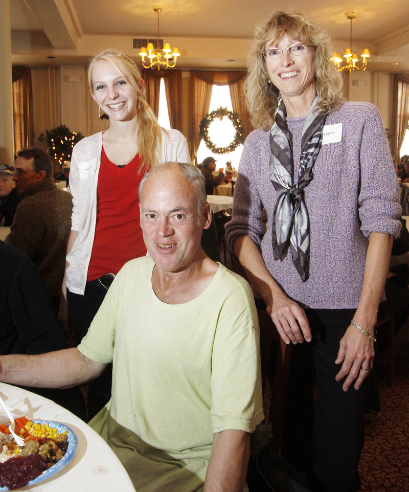 Holly Ayoob of Biddeford and her daughter, Asia Steele, 17, have served Hollis McLaughlin of Portland Thanksgiving dinner every year since 1998, when they started volunteering at the United Way-sponsored community dinner.