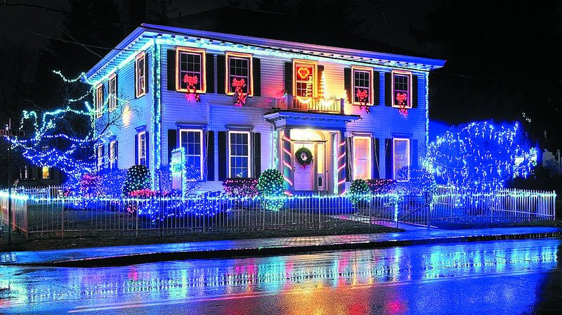 For the second year, the offices of Augusta Orthodontics are lighting up the holiday-season nights. Dr. Darryl Zeleniak, who says National Lampoon movie misadventurer Clark Griswold is his hero, choreographed the display.