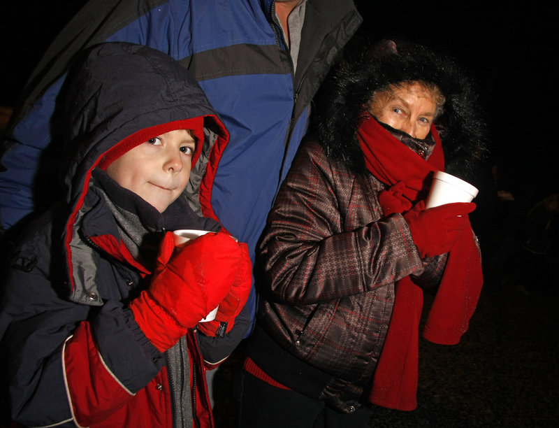 Ben Hines of York, left, and his grandmother, Millie Hines of Florida, enjoy warm cocoa and some cuddling in the cold.
