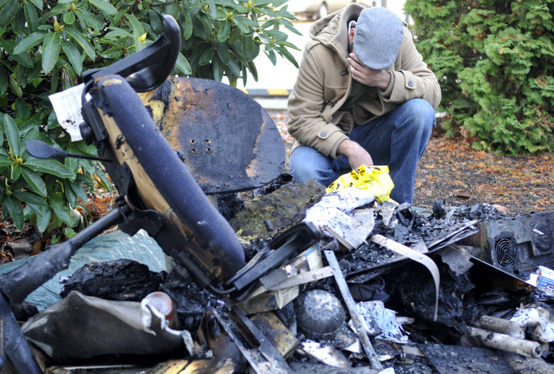 Ahson Saeed of Corvallis, Ore., looks over debris from a local Islamic center. Anger over a teenager's failed plan to blow up a van of explosives during a Christmas tree lighting ceremony apparently erupted in arson at the center once frequented by the suspect.