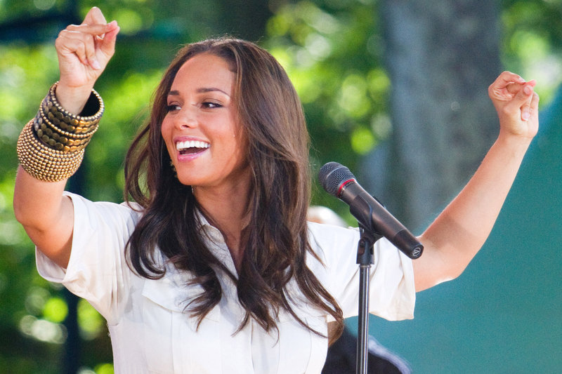Alicia Keys performs in New York's Central Park in June. She and other celebrities have joined a campaign called Digital Life Sacrifice for her charity, Keep a Child Alive.
