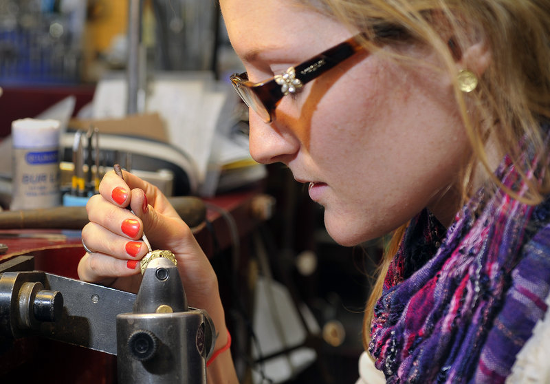 Nell Snyder, a bench jeweler, sets diamonds into an 18-karat gold diamond leaf-swirl band at Folia, a jewelry store on Exchange Steet in Portland. Gold is now about $1,360 per ounce, about twice the price it was in 2006.