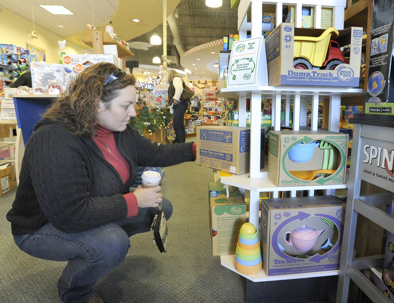 Annette Woodbury of Gray looks at Green Toys, which are made of recycled material, on Monday at Rainbow Toys in Falmouth.