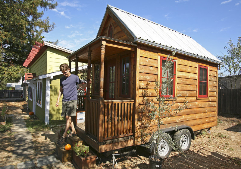Jay Schafer, owner of Tumbleweed Tiny Houses, steps down from a tiny house he built for himself in Graton, Calif. The California homebuilder has become a leader in a small but growing segment of the American housing market: the tiny house.
