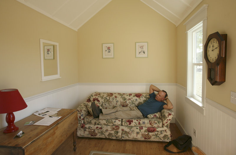 Stephen Marshall, owner of the company Little House on the Trailer, relaxes in one of his one-room houses in Petaluma, Calif. Fully built tiny houses cost about $20,000 to $50,000, but are about half that for do-it-yourselfers.