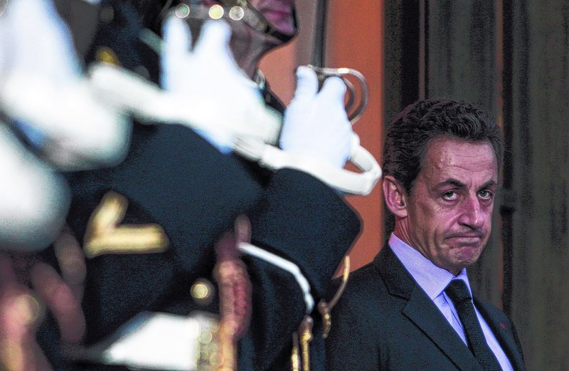 President Nicolas Sarkozy of France awaits Dutch Prime Minister Mark Rutte on Monday at the Elysee Palace in Paris. French media have questioned whether France's public debt, at 83 percent of GDP this year, puts the country at risk.