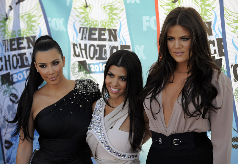 """Kim, from left, Kourtney and Khloe Kardashian want their names and images off """"predatory"""" debit cards."""