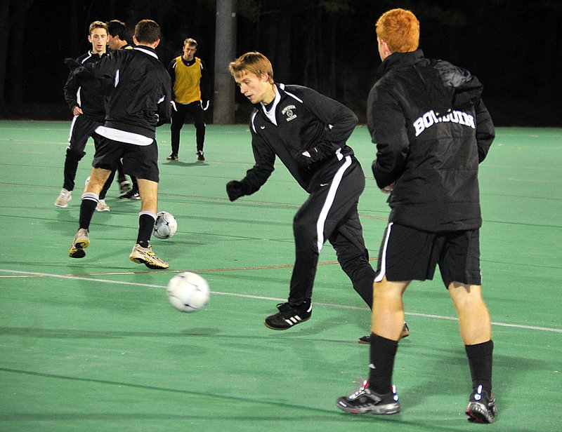 Macgill Eldredge, center, of Cumberland and his Bowdoin teammates practice Monday night in preparation for their NCAA Division III men's soccer semifinal Friday in San Antonio against Lynchburg College. The Polar Bears are making their first appearance in the Final Four.