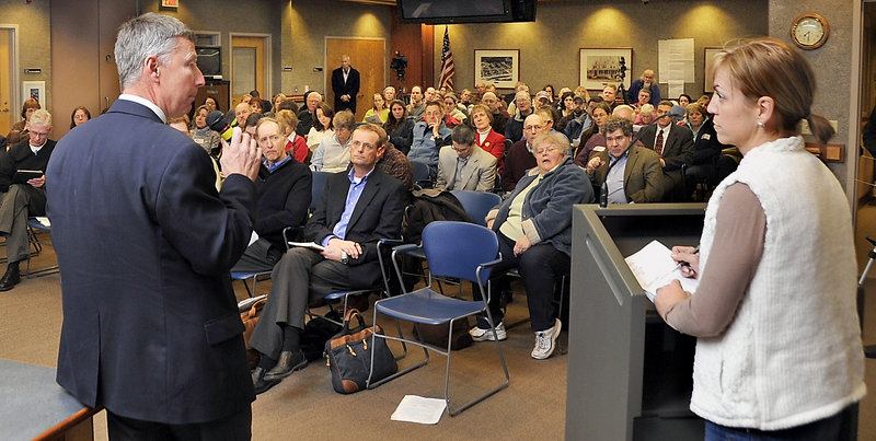 CMP spokesman John Carroll answers a question by Ang Foley of Cape Elizabeth during a public forum concerning smart meters Monday in Scarborough.
