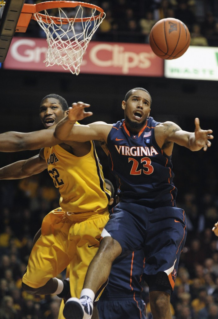 Minnesota's Trevor Mbakwe, left, watches a rebound go to Virginia's Mike Scott during the Cavaliers' 87-79 win Monday night.