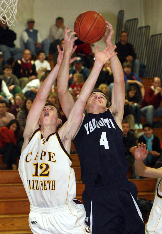 Luke Pierce of Yarmouth, right, attempts to haul in a rebound Tuesday night against Henry Babcock of Cape Elizabeth in the second half. Yarmouth came away with an 84-61 victory on the road.
