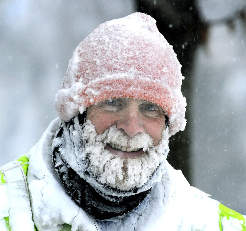 Portlander Chester Bishop smiles as he snowblows a fire hydrant in front of his Pitt St. home as he and all Mainers start to dig out from the largest snowstorm of this season so far. Portland area is expecting 12 to 18 inches.