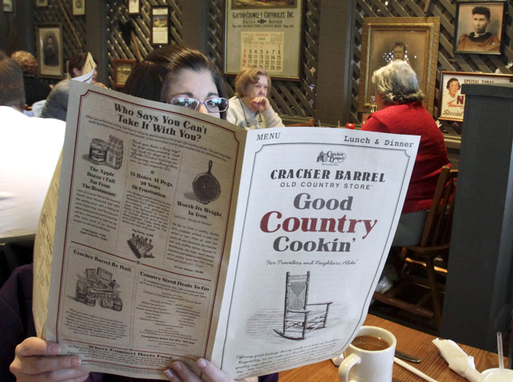 Sonja Woods of Shapleigh reads the menu recently at the Cracker Barrel restaurant and store in South Portland.