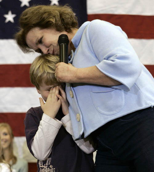 In this January 2008 photo, Elizabeth Edwards, then wife of Democratic presidential hopeful former Sen. John Edwards, hugs their son Jack on stage after he was too embarrassed to talk in Ames, Iowa.