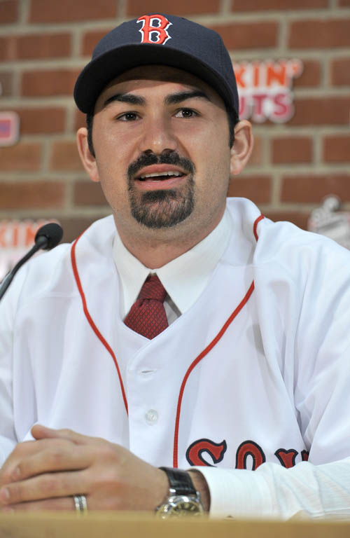 Adrian Gonzalez speaks to reporters during a news conference today at Fenway Park: