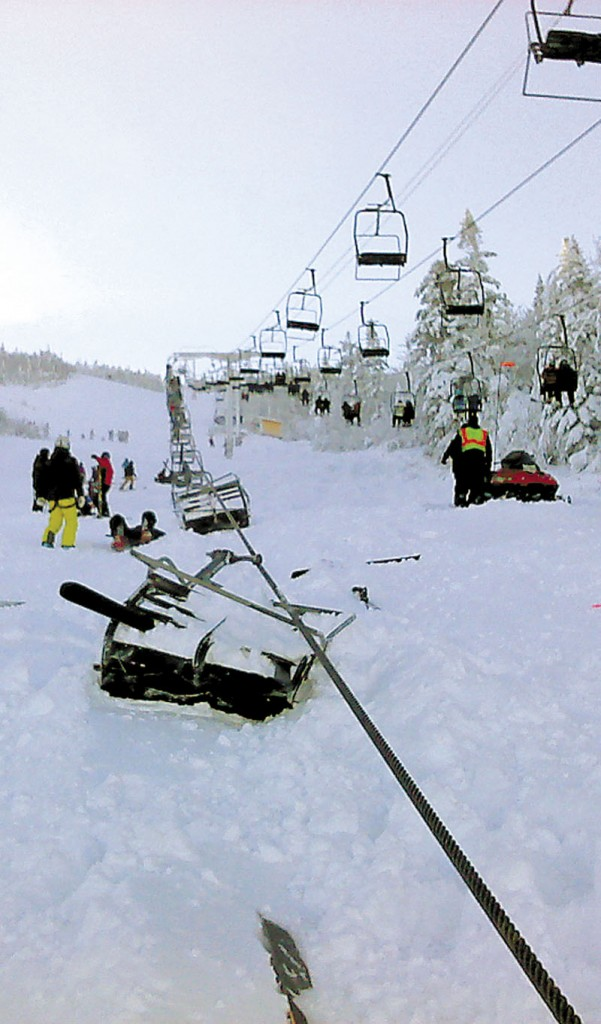 Chairs on the Spillway East chairlift at Sugarloaf rest in the snow after falling as far as 30 feet after the cable derailed Tuesday. The derailment at Maine's tallest ski mountain Tuesday, sent skiers and snowboarders to the ground, injuring at least eight people.