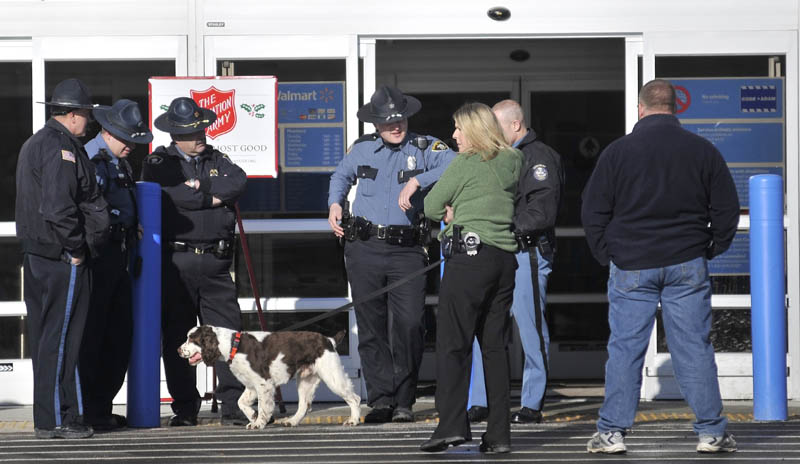 Maine State troopers and police officers stand at the entrance to the the Walmart in Skowhegan with a bomb-sniffing dog after a bomb threat was investigated Thursday afternoon.