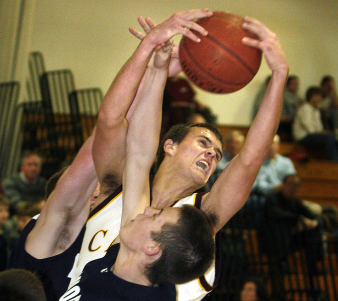 Kyle Danielson of Cape Elizabeth pulls down a rebound over Sam Torres of Yarmouth during the second half of Yarmouth s 84-61 victory in a Western Maine Conference schoolboy basketball game Tuesday night.