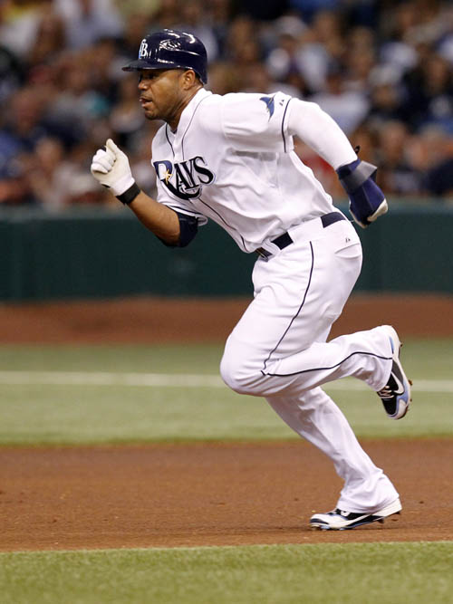 A July 31, 2010, photo showing Tampa Bay Rays' Carl Crawford stealing his 400th career base in the first inning of a baseball game against the New York Yankees, in St. Petersburg, Fla.