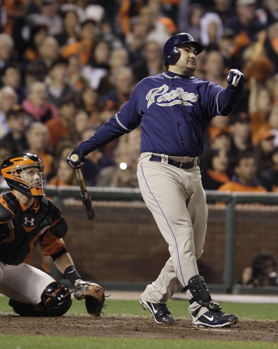 In this Oct. 1, 2010, photo San Diego Padres' Adrian Gonzalez hits a three-run homer in a game against the San Francisco Giants.