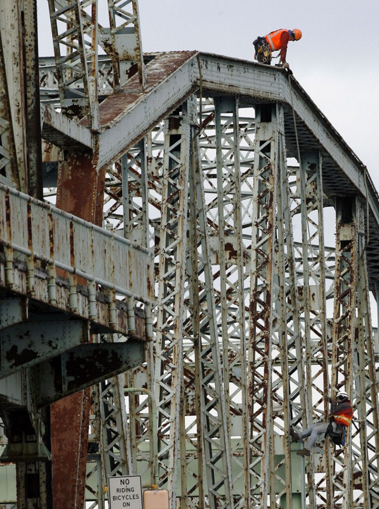 In this Nov. 30, 2010, photo, New Hampshire transportation officials inspect the Memorial Bridge connecting Portsmouth, N.H., with Kittery, Maine. The bridge, which opened in 1923, was closed today due to structural deterioration.