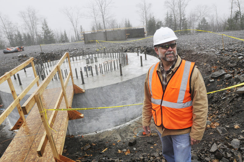 Brad Kites, project manager at the Rollins Mountain wind energy project near Lincoln, is shown at the foundation for a wind turbine on Nov. 8.