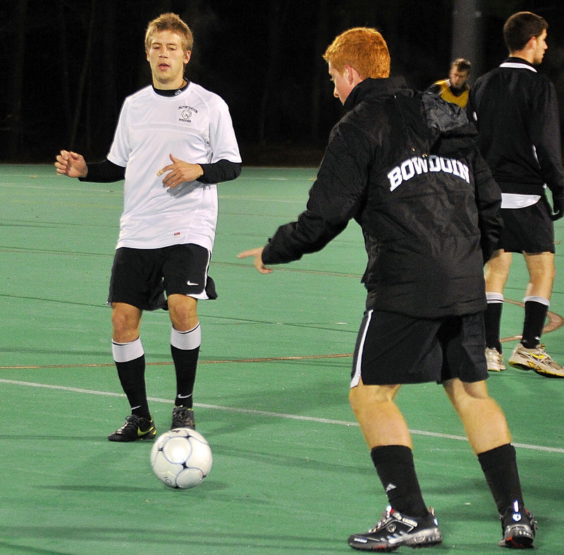 Eddie Jones, left, works with teammate Zach Ostrup as Bowdoin prepares for the NCAA Division III semifinals this weekend. Jones is a key to the Polar Bears' midfield play.