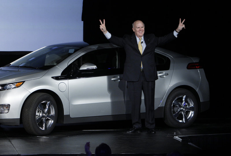 General Motors CEO Dan Akerson, who makes $9 million in annual compensation, celebrates one of the first Chevrolet Volts last month at the plant in Hamtramck, Mich.