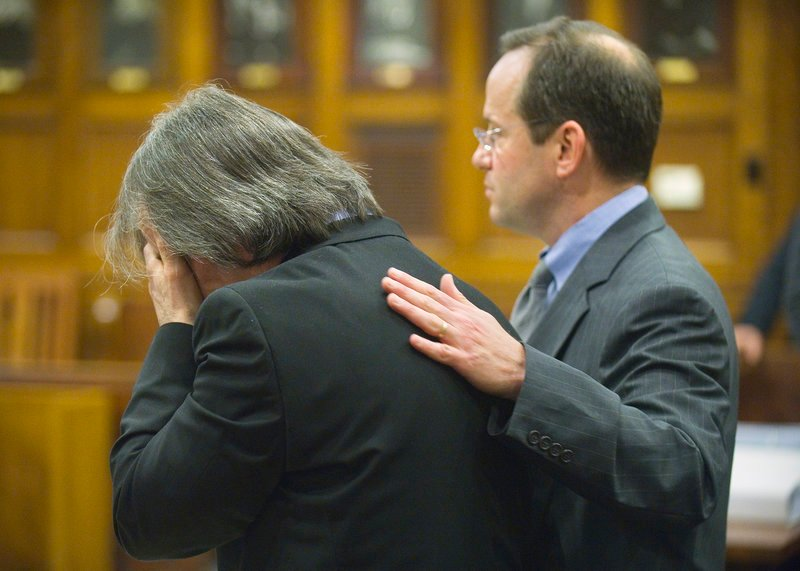 William Hanaman reacts Tuesday to opening statements as his lawyer, Robert Levine, tries to comfort him. Levine said Hanaman acted in self-defense when he killed his girlfriend.