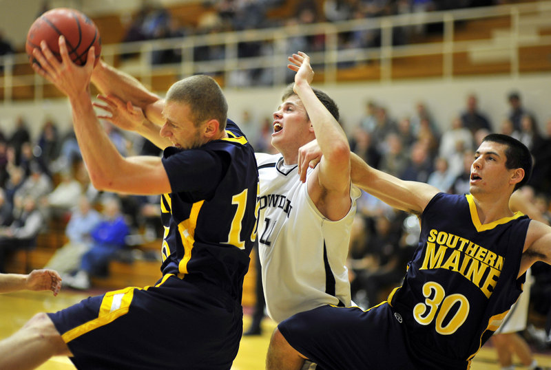 The rebounding gets a bit physical Tuesday night as USM's Leif O'Connell, left, gets inside position on Bowdoin's Will Hanley and teammate Mike Poulin. The Huskies won 70-68, snapping an 11-game losing streak against Bowdoin.