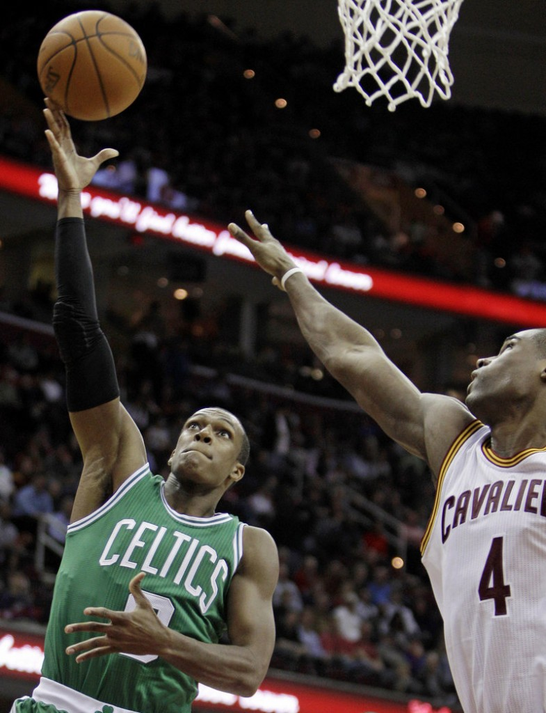 Cleveland forward Antawn Jamison tries to stop a shot by Boston guard Rajon Rondo on Tuesday in Cleveland. Rondo had a season-high 23 points.