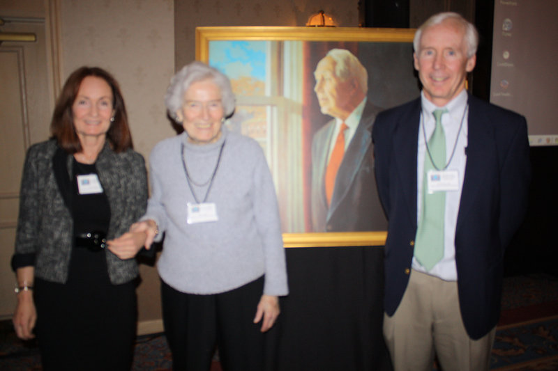 Standing next to a portrait of Dr. Daniel Hanley are, from left, his daughter Sheila Hanley; his widow, Maria Hanley; and his son Dr. Sean Hanley.