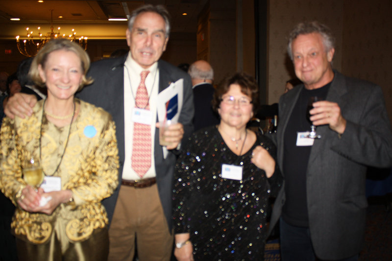 Honoree Elizabeth McLellan, who founded Partners for World Health; Charlie Miller of the Children's Initiative; Leslie Cook of Partners for World Health; Ed Melton of the World Affairs Council
