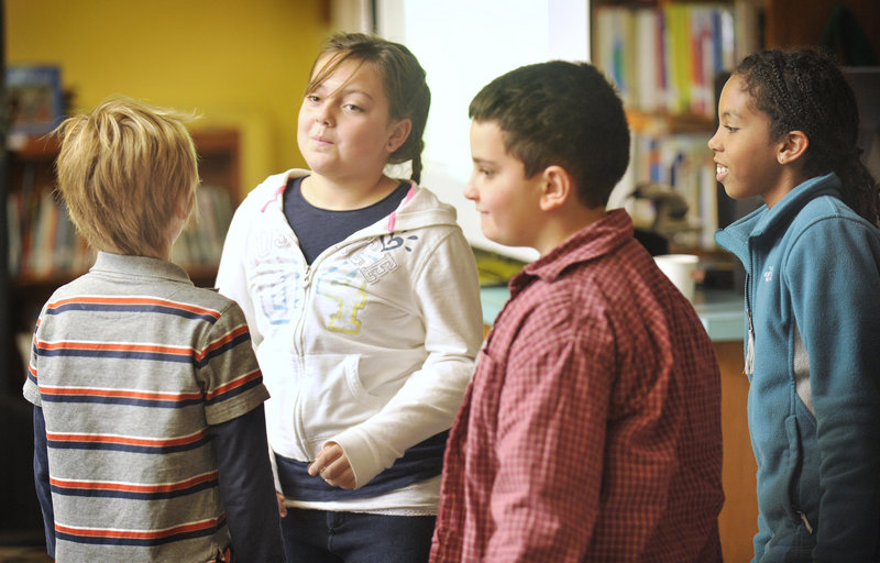 Students Nate Perkins, from left, Maddalena Lapomarda, Vincent Terracciano and Ella Altidor take part in a role-playing scenario on self-esteem Wednesday at Hall Elementary School in Portland.
