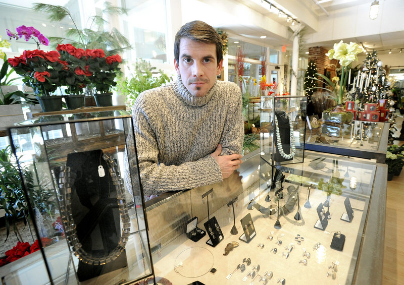 John McVeigh makes and sells his custom jewelry at Compositions, a store on Free Street in Portland.