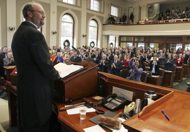 Newly elected House Speaker Robert Nutting, R-Oakland, receives a warm welcome from members of the 125th Maine Legislature after being sworn into office at the State House on Wednesday.