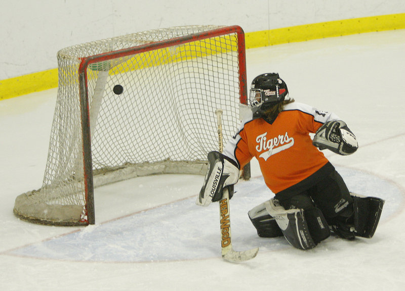 Biddeford goalie Emily Brassley, says Coach Marie Potvin, kept the score respectable as York controlled play during their high school hockey game Wednesday night at Biddeford Ice Arena.