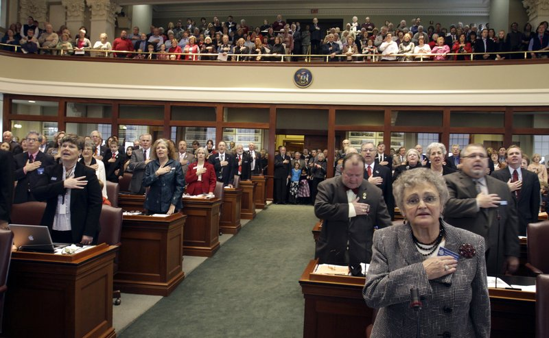 Members of the 125th Maine Legislature take the Pledge of Allegiance before being sworn into office Wednesday in the House chamber. For the first time in more than three decades, there are Republican majorities in both the House and Senate.