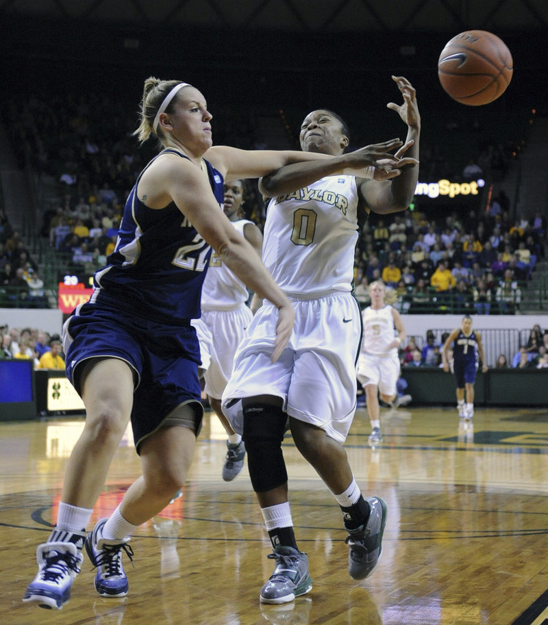 Natalie Novosel, left, of Notre Dame knocks the ball away from Baylor's Odyssey Sims during Wednesday night's game at Waco, Texas. No. 2 Baylor won, 76-65.