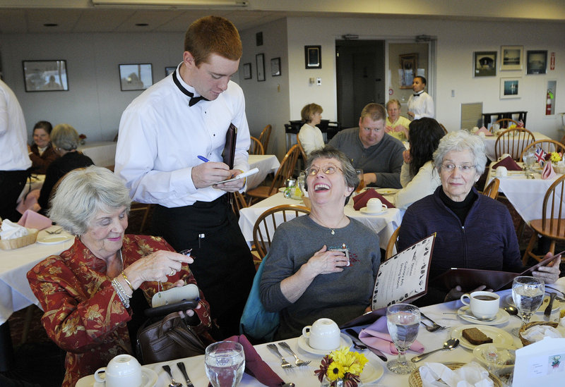 Jeremy Gearly of Lebanon takes orders at Southern Maine Community College as part of the dining room management program. Guests, from left, are Sheila Brown and Rita Landry, both of Westbrook, and Gracia Largay of Cumberland Foreside.